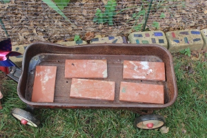Terra-cotta tiles in the bottom for drainage.